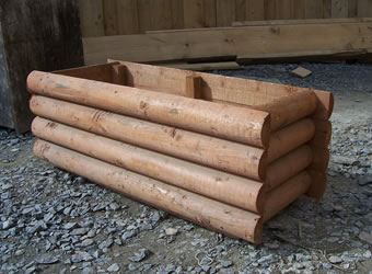 Timber planter with barrel board timber